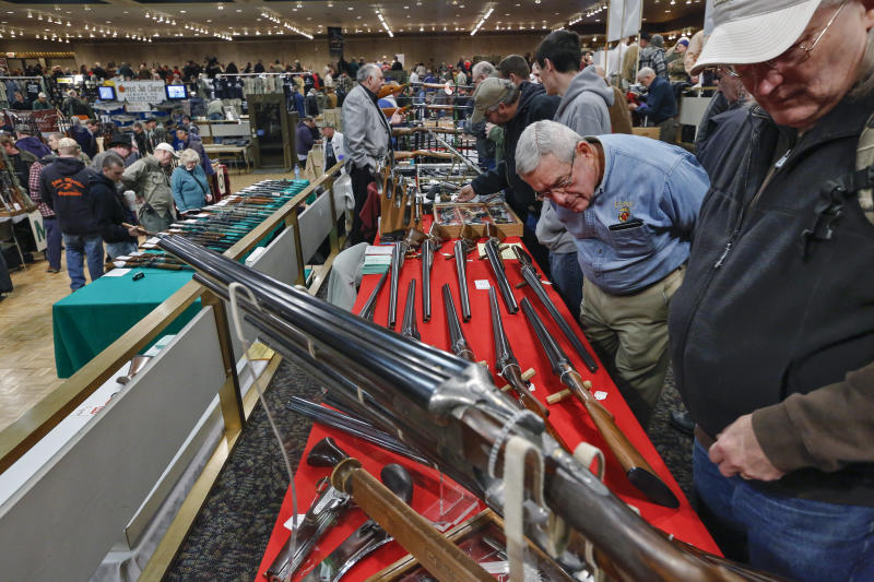 FILE - In this Saturday, Jan. 26, 2013 file photo, gun enthusiasts gather during the annual New York State Arms Collectors Association Albany Gun Show at the Empire State Plaza Convention Center, in Albany, N.Y. Key measures of New York's tough new gun law are set to kick in, with owners of guns now reclassified as assault weapons required to register the firearms and new limits on the number of bullets allowed in magazines. As the new provision takes effect Monday, April 15, 2013, New York's affiliate of the National Rifle Association said it plans to head to court to seek an immediate halt to the magazine limit. (AP Photo/Philip Kamrass, File)