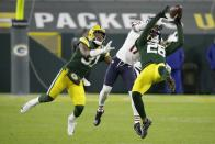 Green Bay Packers' Darnell Savage intercepts a pass in front of Chicago Bears' Anthony Miller during the second half of an NFL football game Sunday, Nov. 29, 2020, in Green Bay, Wis. (AP Photo/Mike Roemer)