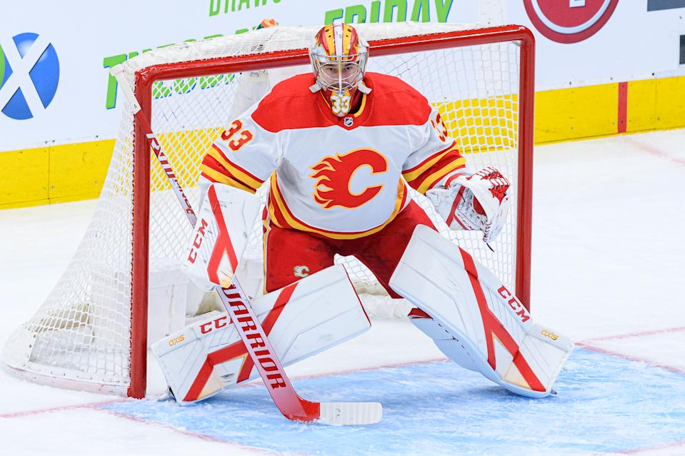 TORONTO, ON - MARCH 20: Calgary Flames Goalie David Rittich (33) tends the net during the NHL regular season game between the Calgary Flames and the Toronto Maple Leafs on March 20, 2021, at Scotiabank Arena in Toronto, ON, Canada. (Photo by Julian Avram/Icon Sportswire via Getty Images)
