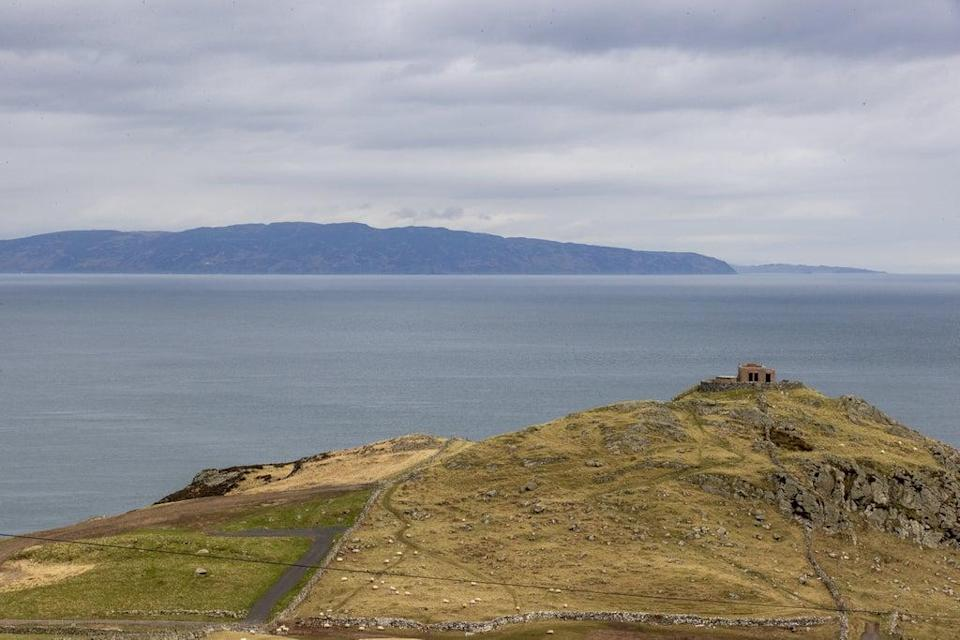 A view from Torr Head on the north Antrim coast looking over the Straits of Moyle towards the tip of the Mull of Kintyre in southwest Scotland which is a distance of 12 miles at its closest (Liam McBurney/PA) (PA Wire)