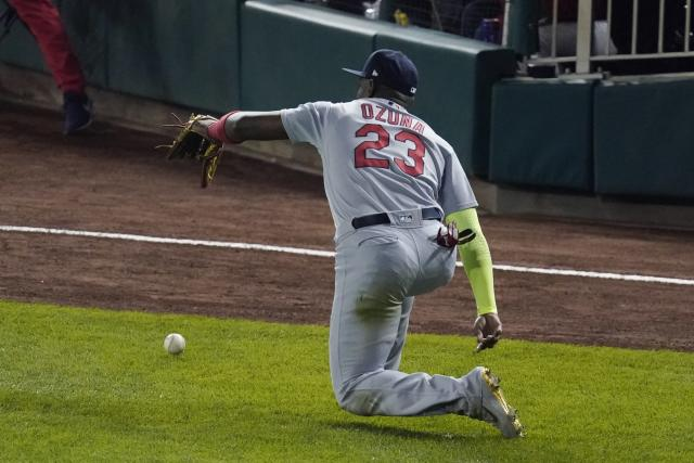 St. Louis Cardinals' Marcell Ozuna can't catch a ball hit by Washington Nationals' Anthony Rendon during the third inning of Game 3 of the baseball National League Championship Series Monday, Oct. 14, 2019, in Washington. Adam Eaton scored on the play. (AP Photo/Alex Brandon)