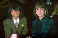 """Fashion designer Kenzo Takada and a friend at a party at """"Maxim' s"""" in 1986 . (Photo by Bertrand Rindoff Petroff/Getty Images)"""