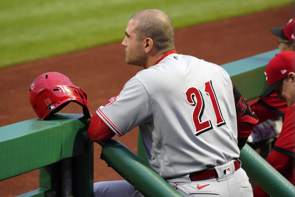 Cincinnati Reds' Joey Votto waits on the dugout steps during the first inning of the team's baseball game against the Pittsburgh Pirates in Pittsburgh, Wednesday, Sept. 15, 2021. Players were permitted to wear the No. 21 in honor of Roberto Clemente Day. (AP Photo/Gene J. Puskar)