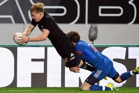 Rugby Union - June Internationals - New Zealand vs France - Eden Park, Auckland, New Zealand - June 9, 2018 - New Zealand's Damian McKenzie scores a try as France's Kevin Gourdon tackles him. REUTERS/Ross Setford