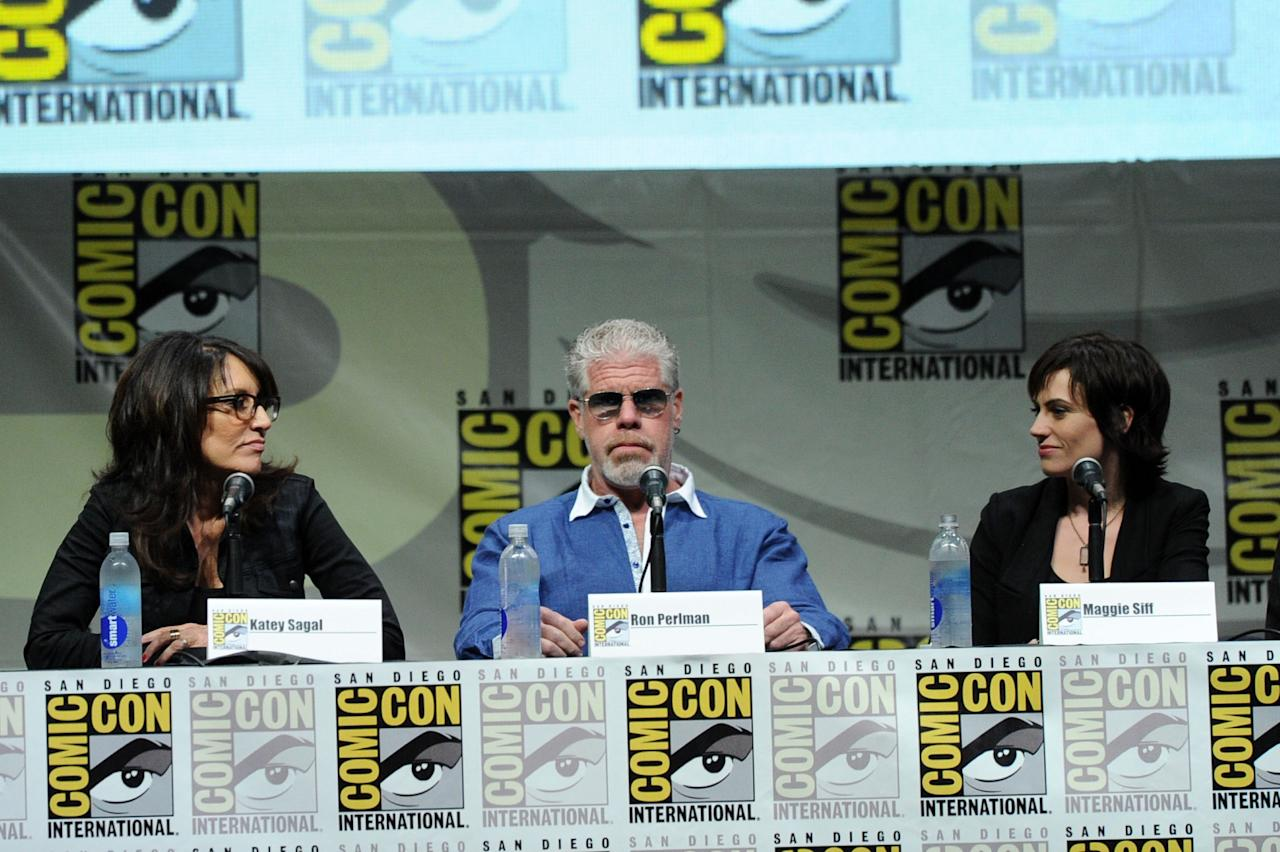 "SAN DIEGO, CA - JULY 21: Actors Katey Sagal, Ron Perlman and Maggie Siff speak onstage at the ""Sons Of Anarchy"" panel during Comic-Con International 2013 at San Diego Convention Center on July 21, 2013 in San Diego, California. (Photo by Kevin Winter/Getty Images)"
