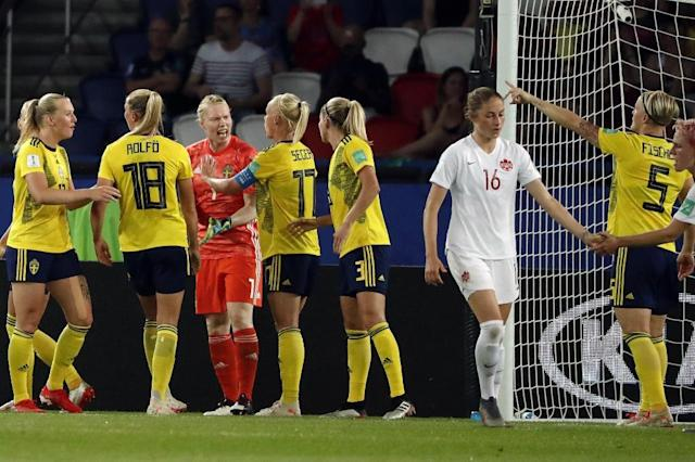Sweden goalkeeper Hedvig Lindahl is congratulated by her teammates after her crucial penalty save helped secure a 1-0 win over Canada in Paris (AFP Photo/THOMAS SAMSON)