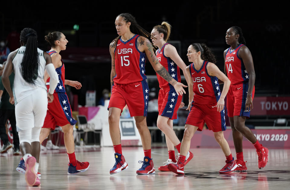 United States of America players celebrate after a three point basket during women's basketball preliminary round game against Nigeria at the 2020 Summer Olympics, Tuesday, July 27, 2021, in Saitama, Japan. (AP Photo/Charlie Neibergall)