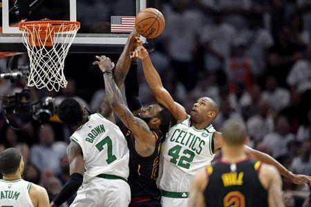 May 25, 2018; Cleveland, OH, USA; Cleveland Cavaliers forward LeBron James (23) goes for a rebound against Boston Celtics forward Al Horford (42) during the fourth quarter in game six of the Eastern conference finals of the 2018 NBA Playoffs at Quicken Loans Arena. Mandatory Credit: David Richard-USA TODAY Sports