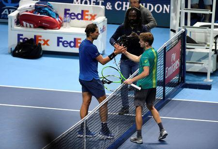 Tennis - ATP World Tour Finals - The O2 Arena, London, Britain - November 13, 2017 Spain's Rafael Nadal shakes the hand of Belgium's David Goffin after their group stage match Action Images via Reuters/Tony O'Brien