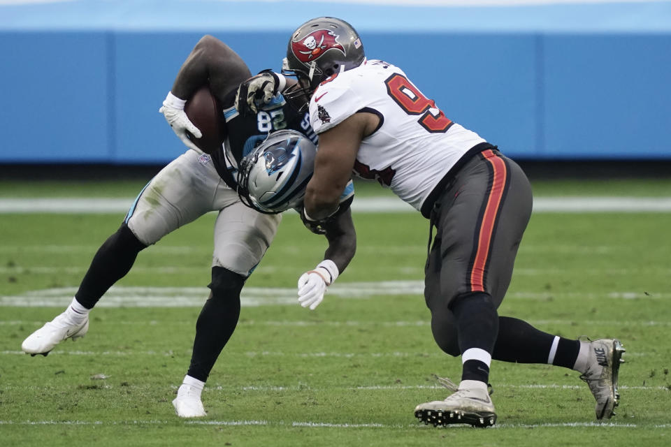 Tampa Bay Buccaneers defensive end Ndamukong Suh (93) hits Carolina Panthers running back Mike Davis (28) during the second half of an NFL football game, Sunday, Nov. 15, 2020, in Charlotte , N.C. (AP Photo/Gerry Broome)