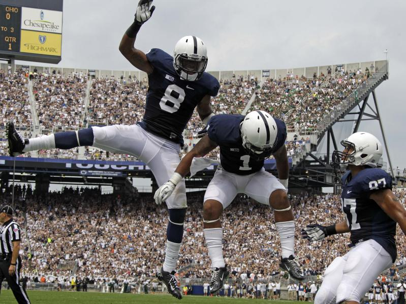Penn State running back Bill Belton (1) celebrates with teammates wide receiver Allen Robinson (8) and tight end Kyle Carter (87) after rushing for the first touchdown of the new season during the first quarter of an NCAA college football game against Ohio at Beaver Stadium in State College, Pa., Saturday, Sept. 1, 2012. (AP Photo/Gene J. Puskar)