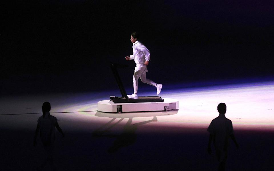 A performer is seen acting during the Opening Ceremony of the Tokyo 2020 Olympic Games - Clive Rose/Getty Images
