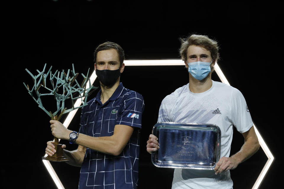 Germany's Alexander Zverev, right, and Russia's Daniil Medvedev hold theur trophy after the Paris Masters tennis tournament final, Sunday, Nov. 8, 2020 in Paris. Daniil Medvedev won the Paris Masters for the first time by beating Alexander Zverev 5-7, 6-4, 6-1 on Sunday for his eighth career title and third at a Masters event. (AP Photo/Christophe Ena)