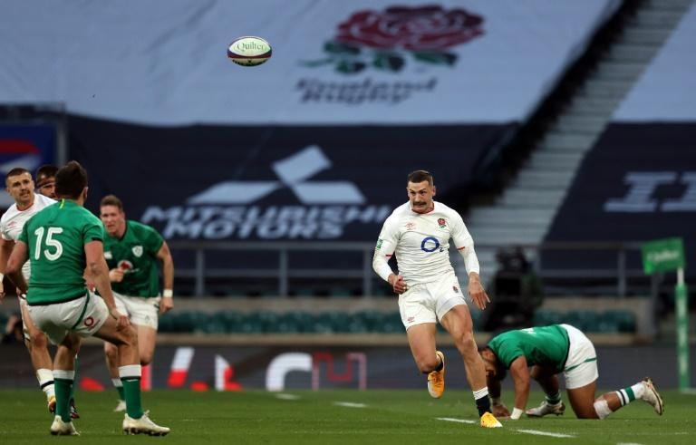 Catch me if you can: England's wing Jonny May in action against Ireland