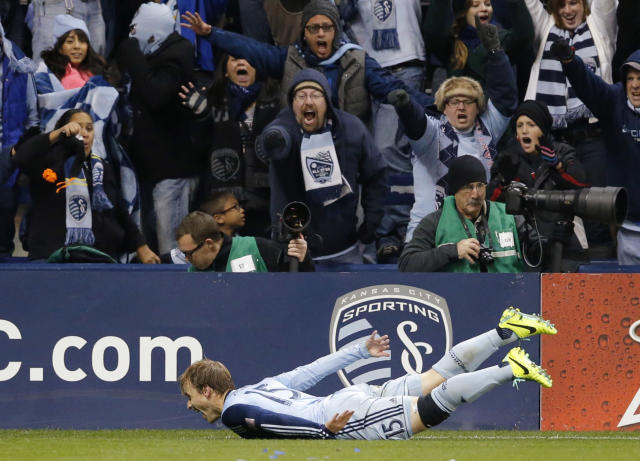 Sporting Kansas Kansas City defender Seth Sinovic (15) celebrates his goal during the second half of an MLS playoff soccer match against the New England Revolution in Kansas City, Kan., Wednesday, Nov. 6, 2013. (AP Photo/Orlin Wagner)