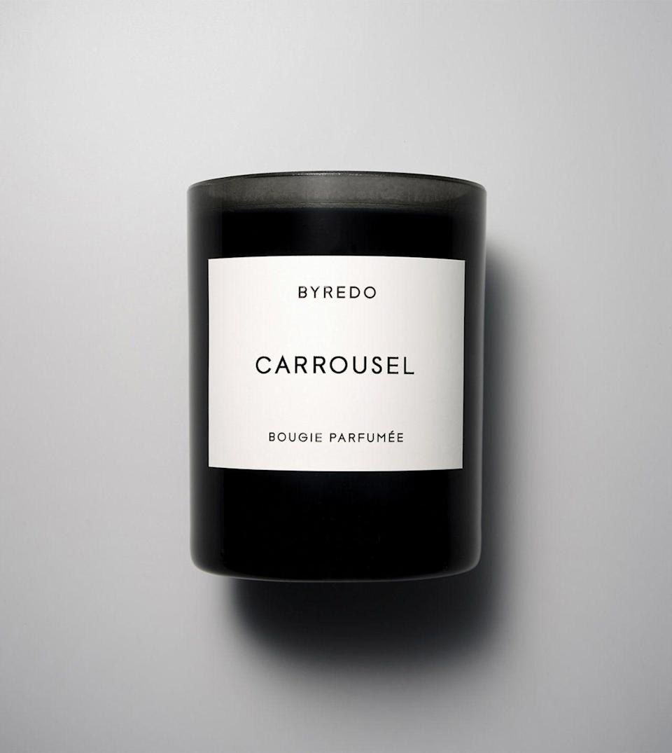 "<p><strong>Byredo</strong></p><p>byredo.com</p><p><strong>$85.00</strong></p><p><a href=""https://www.byredo.com/us_en/carrousel-candle-240g"" rel=""nofollow noopener"" target=""_blank"" data-ylk=""slk:Shop Now"" class=""link rapid-noclick-resp"">Shop Now</a></p><p><strong>Smells like:</strong> mouth-watering orange peels, rhubarb, and figs, alongside vetiver, amber, and woods. This one's for you if you love when a friend comes over and immediately asks why your home smells so good. </p>"