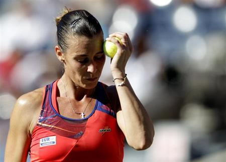 Flavia Pennetta of Italy reacts to a missed point against Victoria Azarenka of Belarus at the U.S. Open tennis championships in New York September 6, 2013. REUTERS/Shannon Stapleton