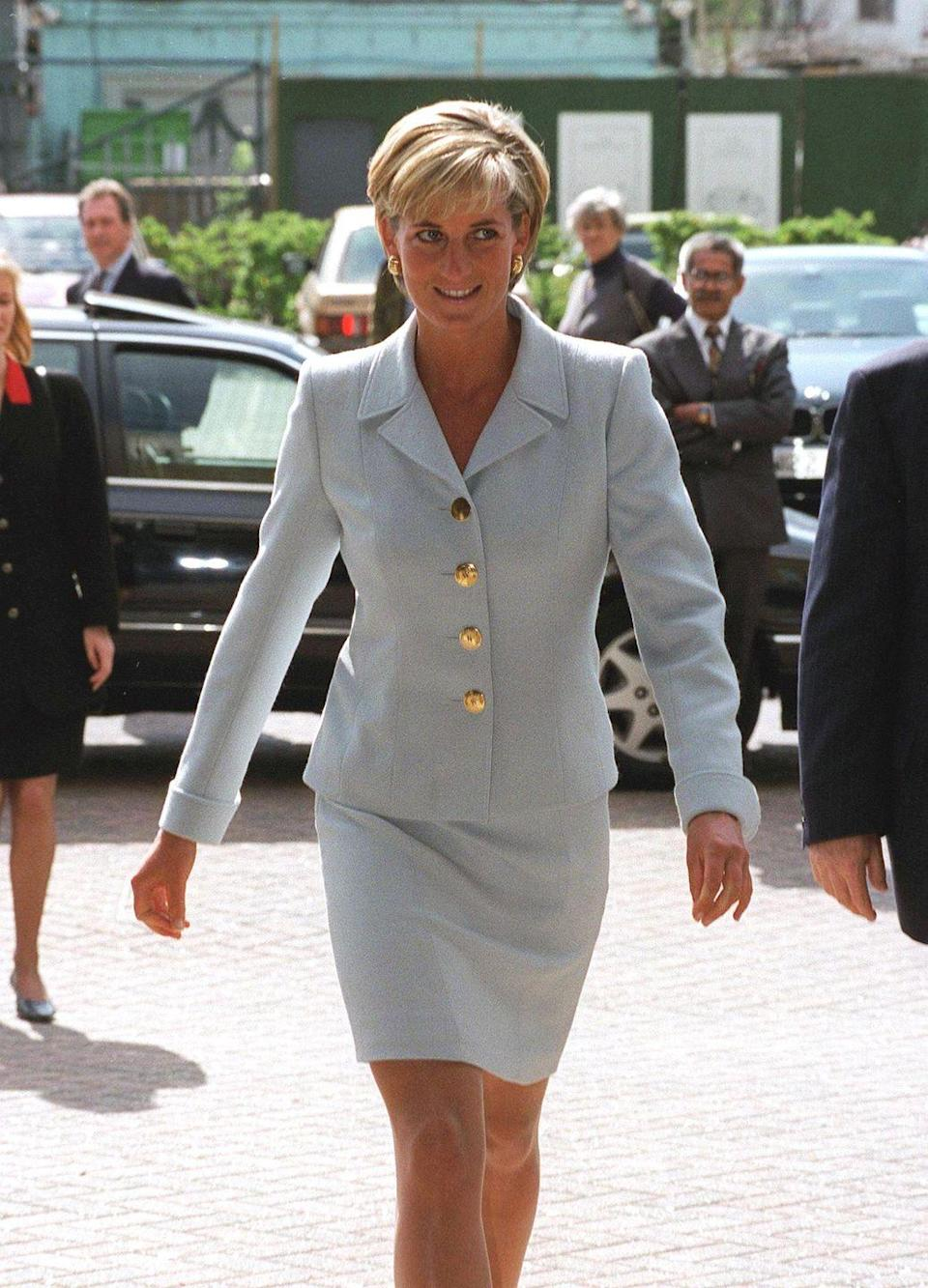 <p>In April 1997, Diana wore one of her most iconic looks–a blue Versace blazer and matching skirt–on a visit to the Royal Brompton Hospital.<br></p>
