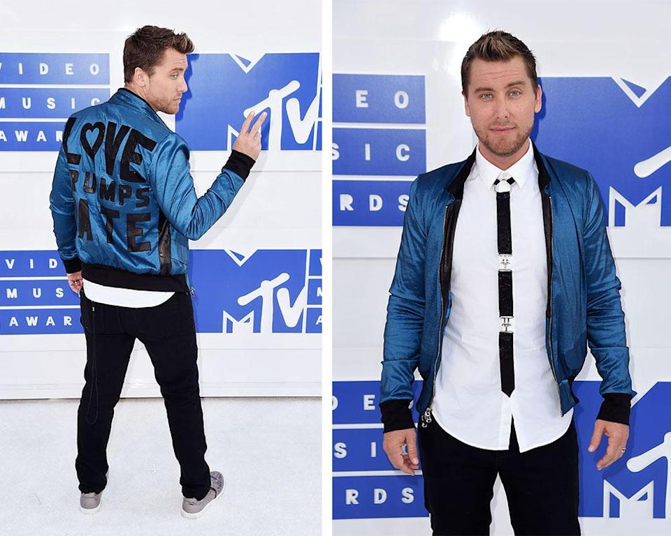 """<p>The former boy-bander made a political in addition to a fashion statement, wearing a blue satin bomber with the words """"Love Trumps Hate"""" on the back. He also had on a bondage-inspired tie. <i>(Photo: Getty Images)</i></p>"""