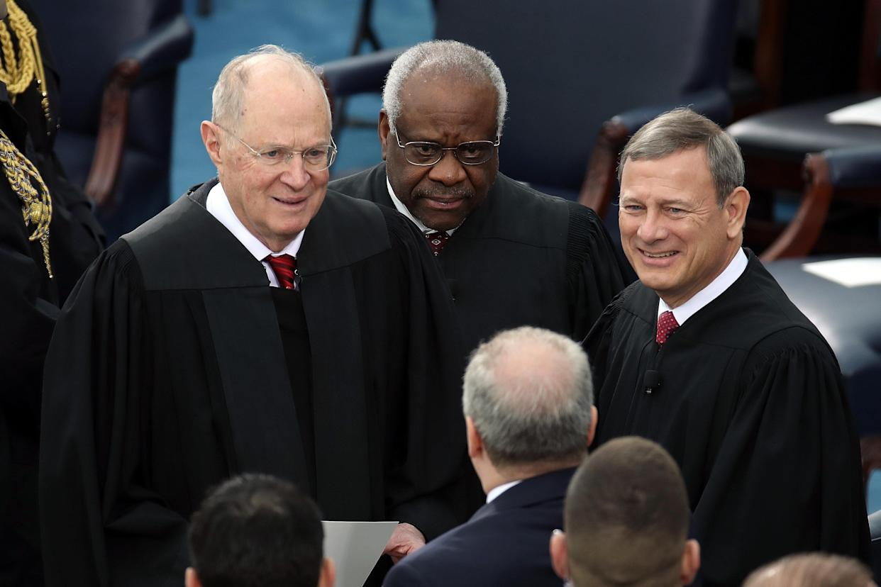 Supreme Court Justices Anthony Kennedy, Clarence Thomas and John Roberts attend President Donald Trump's inauguration ceremony on Jan. 20, 2017, in Washington, D.C. (Drew Angerer via Getty Images)