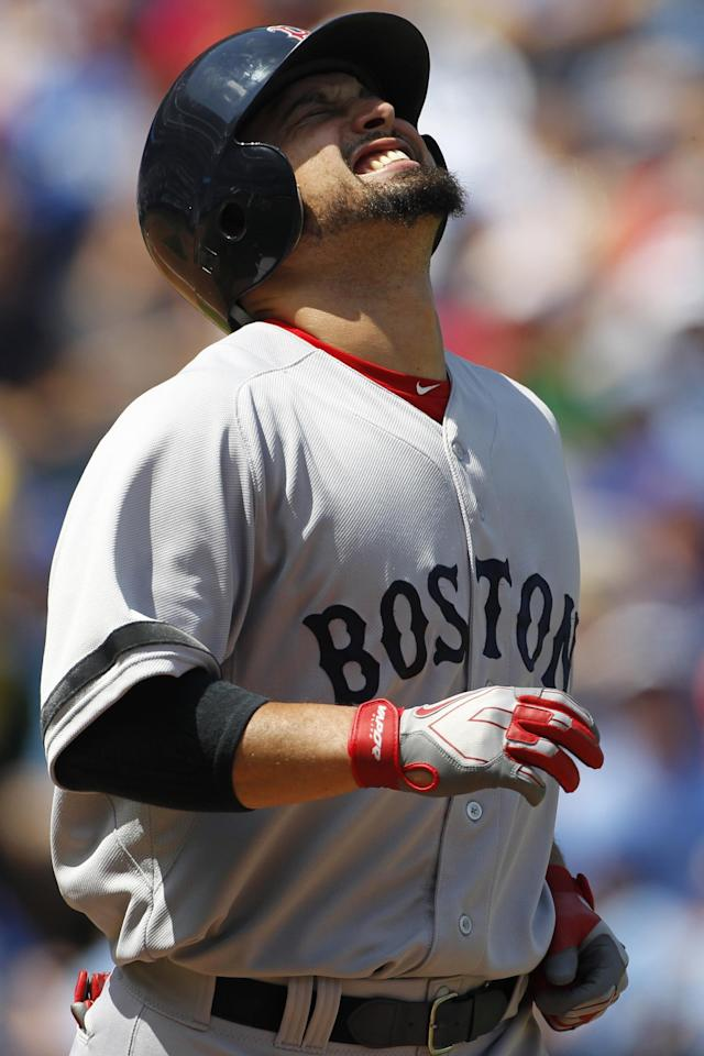 Boston Red Sox's Shane Victorino reacts after being hit by a pitch in the second inning of a baseball game against the Kansas City Royals at Kauffman Stadium in Kansas City, Mo., Sunday, Aug. 11, 2013. (AP Photo/Colin E. Braley)