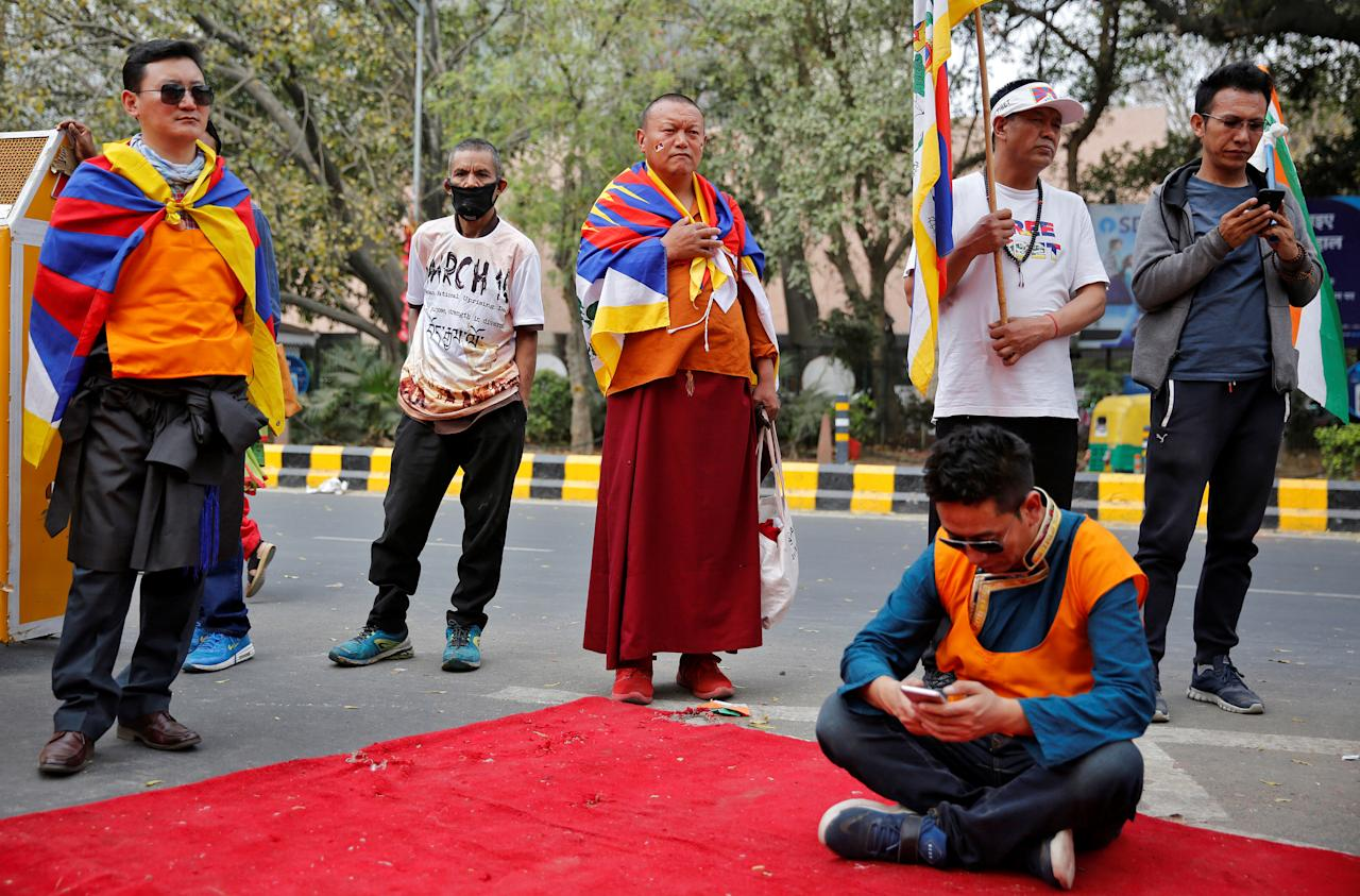 <p>Tibetan exiles attend a protest held to mark the 10th anniversary of a Tibetan uprising against Chinese rule, in New Delhi, India, March 14, 2018. REUTERS/Cathal McNaughton </p>