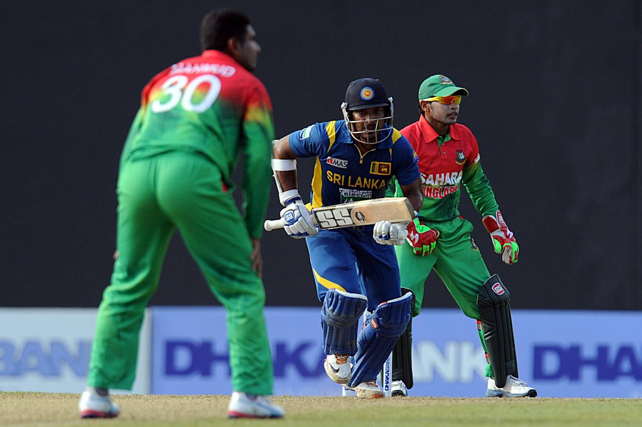 Sri Lankan cricketer Kumar Sangakkara (C) runs between wickets as Bangladesh cricket captain Mushfiqur Rahim (R) looks on during the third and final one-day international (ODI) match between Sri Lanka and Bangladesh at The  Pallekele International Cricket Stadium in Pallekele on March 28, 2013. AFP PHOTO/ Ishara S. KODIKARA        (Photo credit should read Ishara S.KODIKARA/AFP/Getty Images)