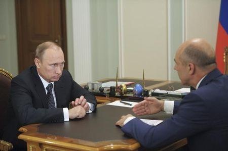 Russian President Putin speaks with Finance Minister Siluanov during their meeting at the Novo-Ogaryovo state residence