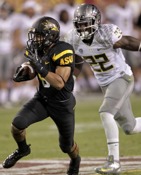 Arizona State running back D.J. Foster gains yards as Oregon linebacker Derrick Malone (22) defends during the second half of an NCAA college football game, Thursday, Oct. 18, 2012, in Tempe, Ariz. (AP Photo/Matt York)