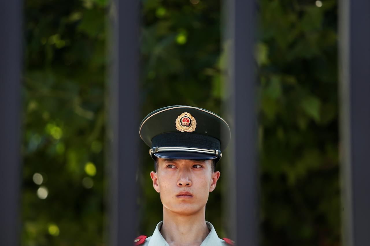 <p>A paramilitary police officer stands guard near the site of a blast at the U.S. Embassy in Beijing, July 26, 2018. (Photo: Damir Sagolj/Reuters) </p>