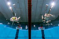 <p>An underwater view shows Finland's Matti Mattsson (R) and Australia's Izaac Stubblety-Cook diving to start a semi-final of the men's 200m breaststroke swimming event during the Tokyo 2020 Olympic Games at the Tokyo Aquatics Centre in Tokyo on July 28, 2021. (Photo by François-Xavier MARIT / AFP)</p>