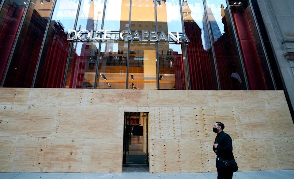 A Dolce & Gabbana store on 5th Avenue in New York boarded up on November 1. Source: Getty