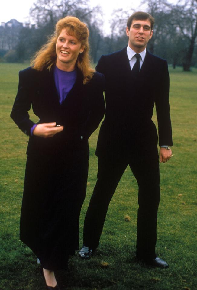 <p>Sarah Ferguson made her fashionable debut on 17 March 1986 after Buckingham Palace announced her engagement to Prince Andrew. For the history-making occasion, she donned a black coat (shoulder pads included) and a violet-hued dress. <em>[Photo: Getty]</em> </p>