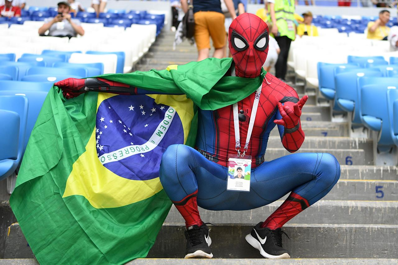 <p>A Brazil's fan dressed as spiderman cheers with the Brazilian national flag prior to the Russia 2018 World Cup round of 16 football match between Brazil and Mexico at the Samara Arena in Samara on July 2, 2018. (Photo by MANAN VATSYAYANA / AFP) </p>