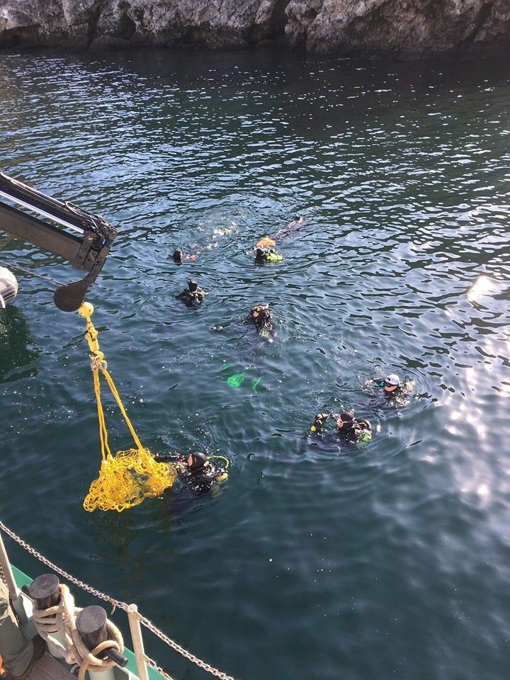 Dive teams work near the area of the sunken Conception in the days after the fire.