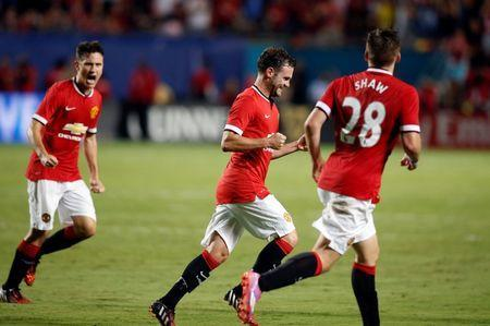 Aug 4, 2014; Miami Gardens, FL, USA; Manchester United midfielder Anderson (8) celebrates his goal against Liverpool in the second half with Luke Shaw (28) at Sun Life Stadium. Mandatory Credit: Robert Mayer-USA TODAY Sports