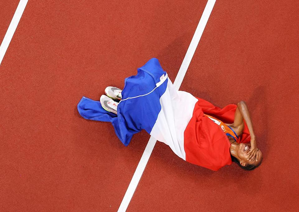 <p>Team Netherlands' Sifan Hassan lays on the track after placing first in the Women's 5000 metres Final at Olympic Stadium on August 2.</p>