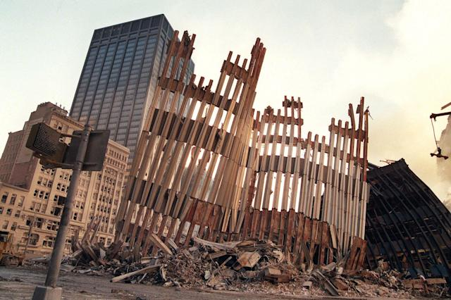 <p>Remains of the façade of 2 World Trade Center is all that stands after Tuesday's terrorist attack, Wednesday, Sept. 12, 2001, in New York. (Photo: Nick Fanelli/AP) </p>