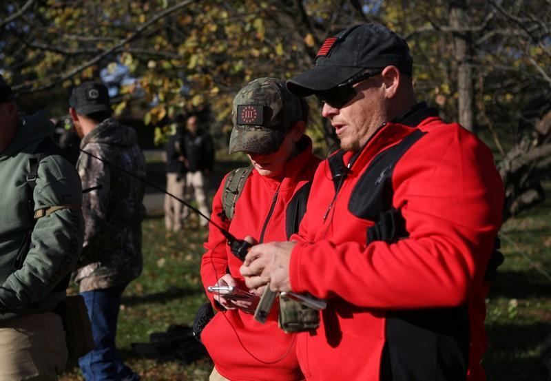 """Militia members and pro-gun rights activists participating in the """"Declaration of Restoration"""" rally prepare to march to Washington, D.C. from Arlington, Virginia"""