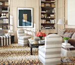 """<p>Tiger print carpets and contemporary artwork make a dramatic statement in the study of this Manhattan pied-à-terre designed by Daniel Romualdez. Focused on adding a fashionable yet not-too-stuffy layer to the room, Romualdez covered antique pieces with modern textiles, like the vintage Billy Baldwin slipper chairs he reupholstered in a <a href=""""https://www.zimmer-rohde.com/en/zr/homepage/"""" rel=""""nofollow noopener"""" target=""""_blank"""" data-ylk=""""slk:Zimmer + Rohde"""" class=""""link rapid-noclick-resp"""">Zimmer + Rohde</a> fabric. A piece of art from American artist Conrad Marca Relli acts as the study's focal point. The carpet is from <a href=""""https://pattersonflynnmartin.com/"""" rel=""""nofollow noopener"""" target=""""_blank"""" data-ylk=""""slk:Patterson Flynn Martin"""" class=""""link rapid-noclick-resp"""">Patterson Flynn Martin</a>. <br></p>"""