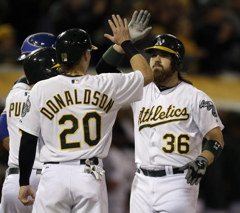 Norris leads A's past Darvish, Rangers 10-6