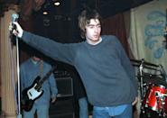 <p>Liam performing in London in 1994.</p>