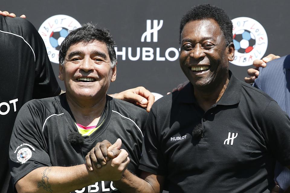 Former Argentinian football international Diego Maradona (L) and former Brazilian footballer Pele pose after a football match organised by Swiss luxury watchmaker Hublot at the Jardin du Palais Royal in Paris on June 9, 2016, on the eve of the Euro 2016 European football championships. (Photo by PATRICK KOVARIK / AFP) (Photo by PATRICK KOVARIK/AFP via Getty Images)