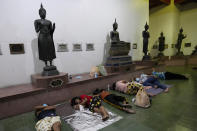 Locals sleep in line overnight for free coronavirus testing at Wat Phra Si Mahathat temple in Bangkok, Thailand, Friday, July 9, 2021. Faced with rapidly rising numbers of new coronavirus infections and growing concern over the proliferation of the highly contagious delta variant, major Asia-Pacific cities implemented new restrictions Friday in the hope of reversing the trend before health care systems are overwhelmed. (AP Photo/Sakchai Lalit)