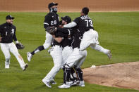 Chicago White Sox starting pitcher Carlos Rodon, center, celebrates his no hitter against the Cleveland Indians with his teammates in a baseball game, Wednesday, April, 14, 2021, in Chicago. (AP Photo/David Banks)