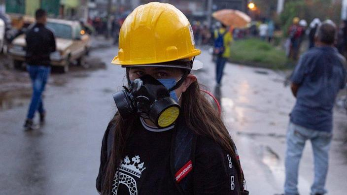 A protester wearing a gas mask in Medellín on 2 June 2021