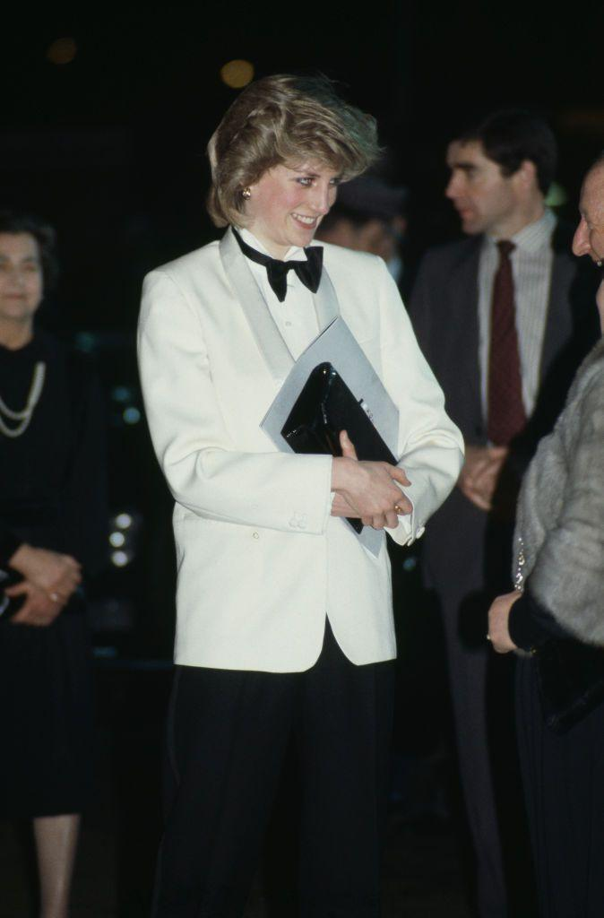 <p>The late Princess of Wales wore a Margaret Howell tuxedo with a white dinner jacket to leave the Birmingham airport in 1984. </p>