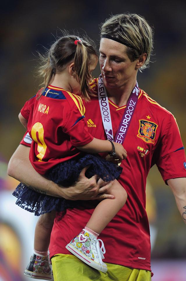KIEV, UKRAINE - JULY 01: Fernando Torres of Spain celebrates their victory with his daughter Nora Torres after the UEFA EURO 2012 final match between Spain and Italy at the Olympic Stadium on July 1, 2012 in Kiev, Ukraine. (Photo by Shaun Botterill/Getty Images)