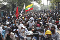 Protesters made up of teachers, medical students and other university students gather for an anti-coup demonstration in Mandalay, Myanmar Saturday, March 13, 2021. Police in Myanmar fired rubber bullets and tear gas at protesters in the country's two largest cities and elsewhere on Friday, as authorities continued their harsh crackdown on opponents of last month's military coup. (AP Photo)