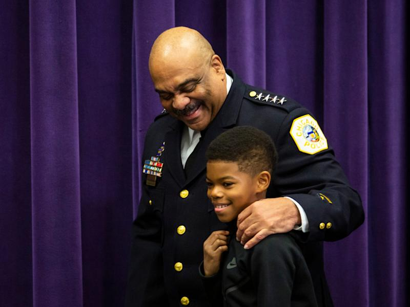 Chicago Police Department Supt. Eddie Johnson puts his arm around his 10-year-old son as he walks into a press conference at CPD headquarters to announce his retirement, Thursday morning, Nov. 7, 2019.